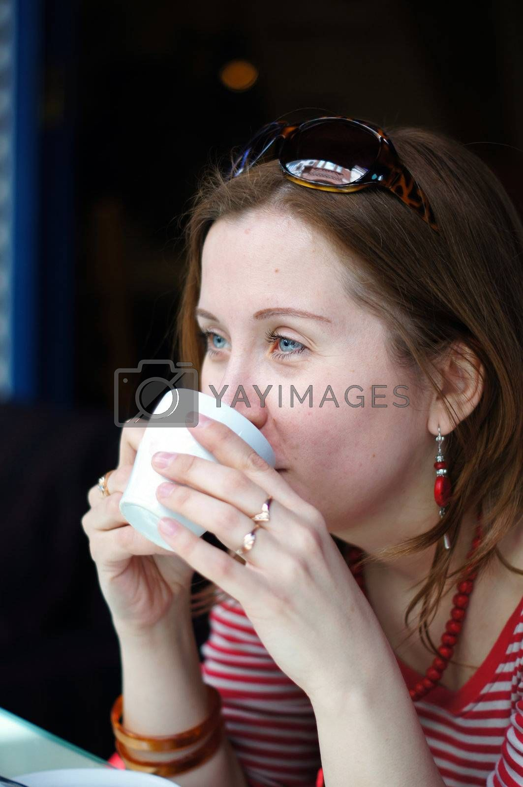 Nice blond woman drinking coffee by Elet