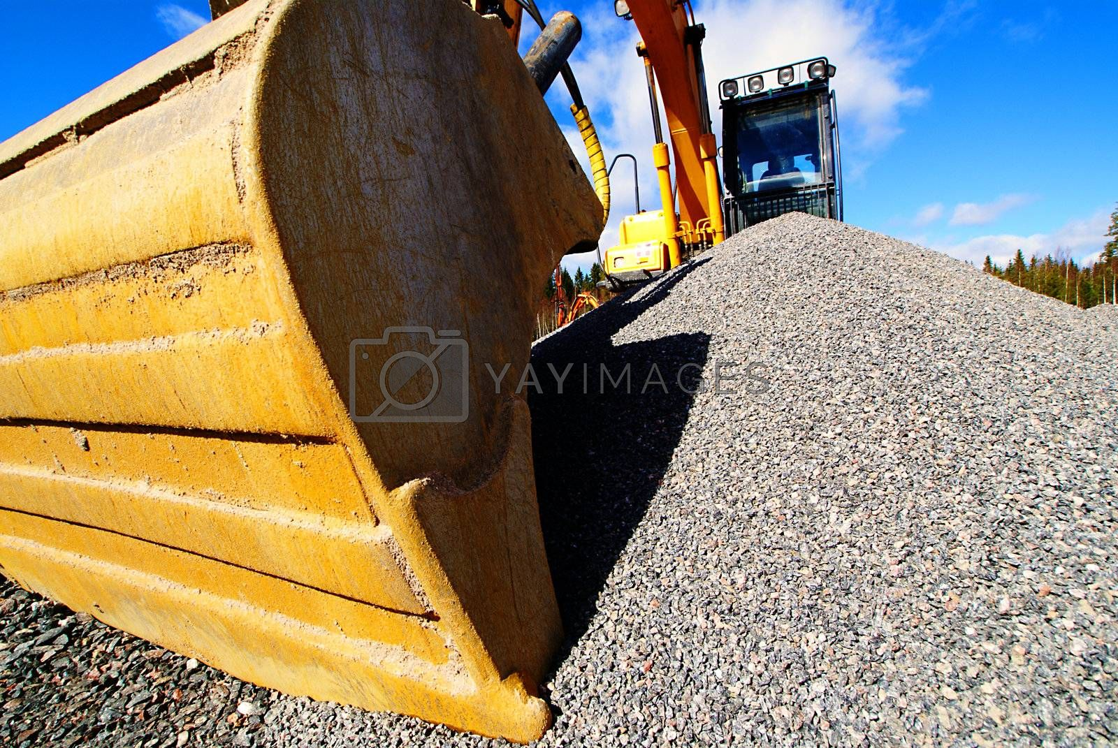 excavator on construction of industrial factory