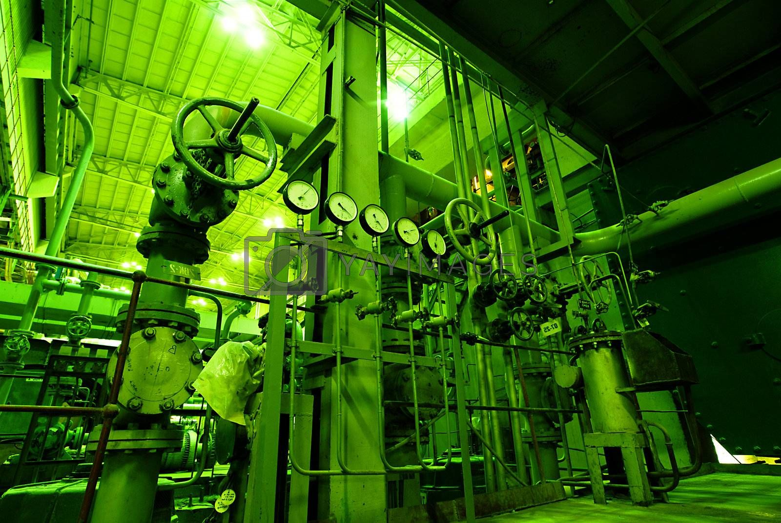 Equipment, cables and piping as found inside of a modern industr by nostal6ie