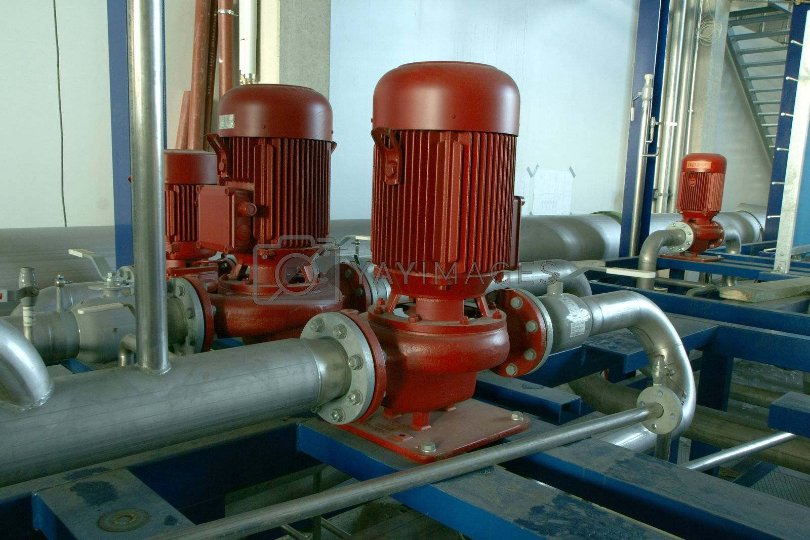 Industrial zone, Steel pipelines and pumps at factory