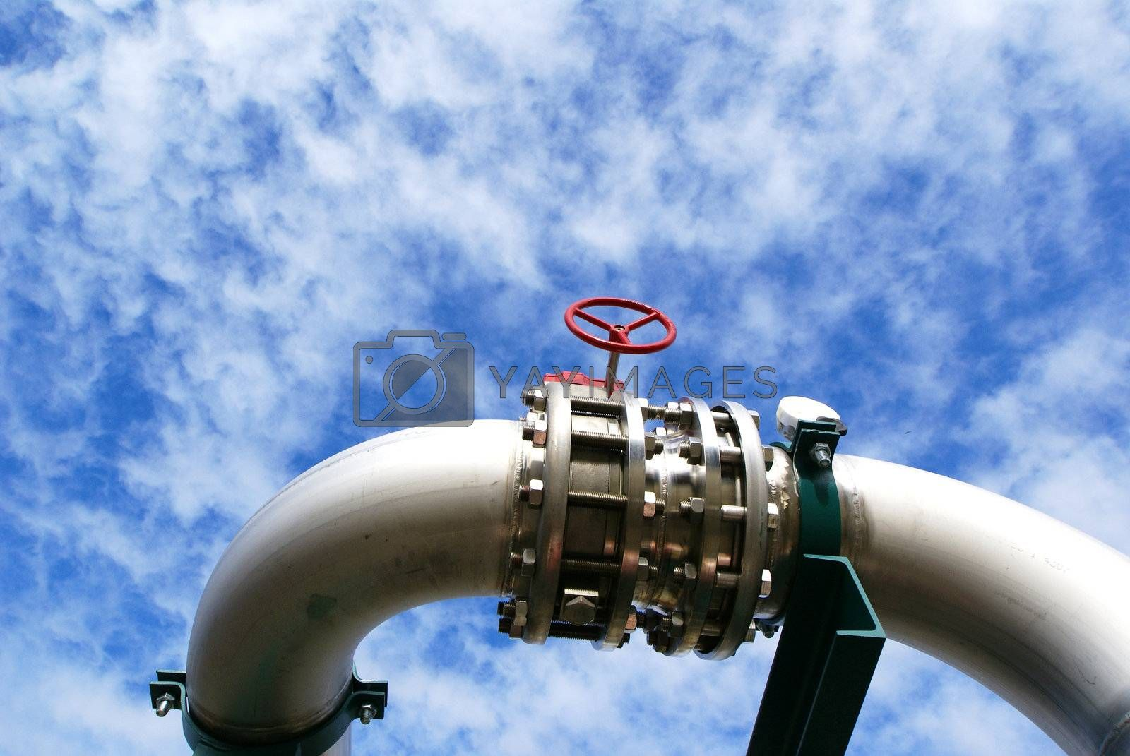 industrial pipelines and valve with a natural blue background