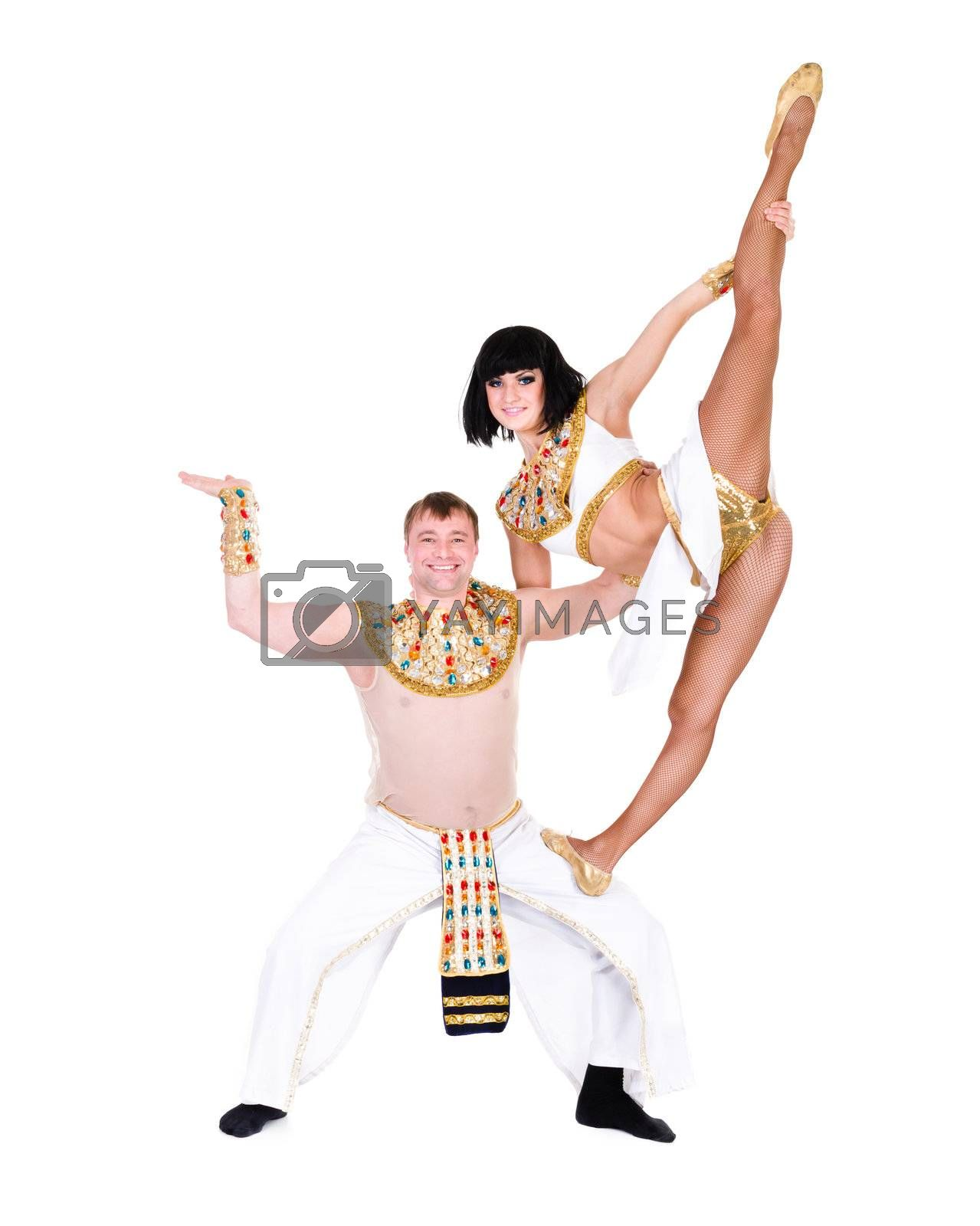 acrobatic dance couple wearing a egyptian costume doing splits against isolated white background