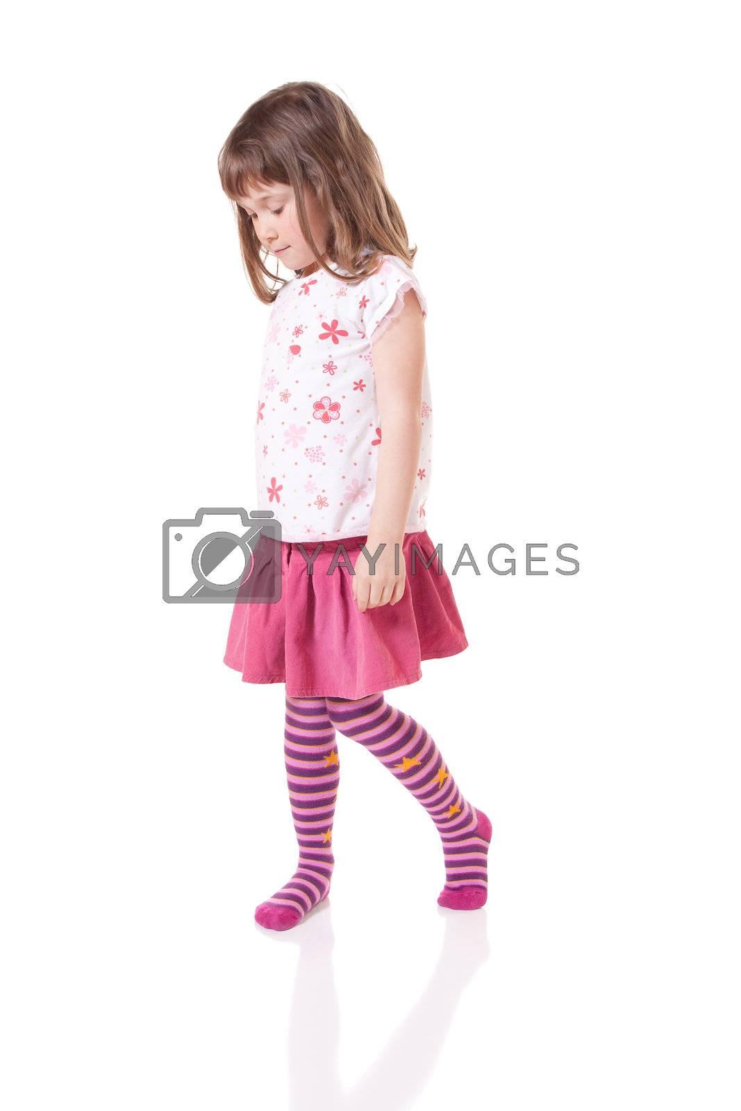 Cute little girl looking shy