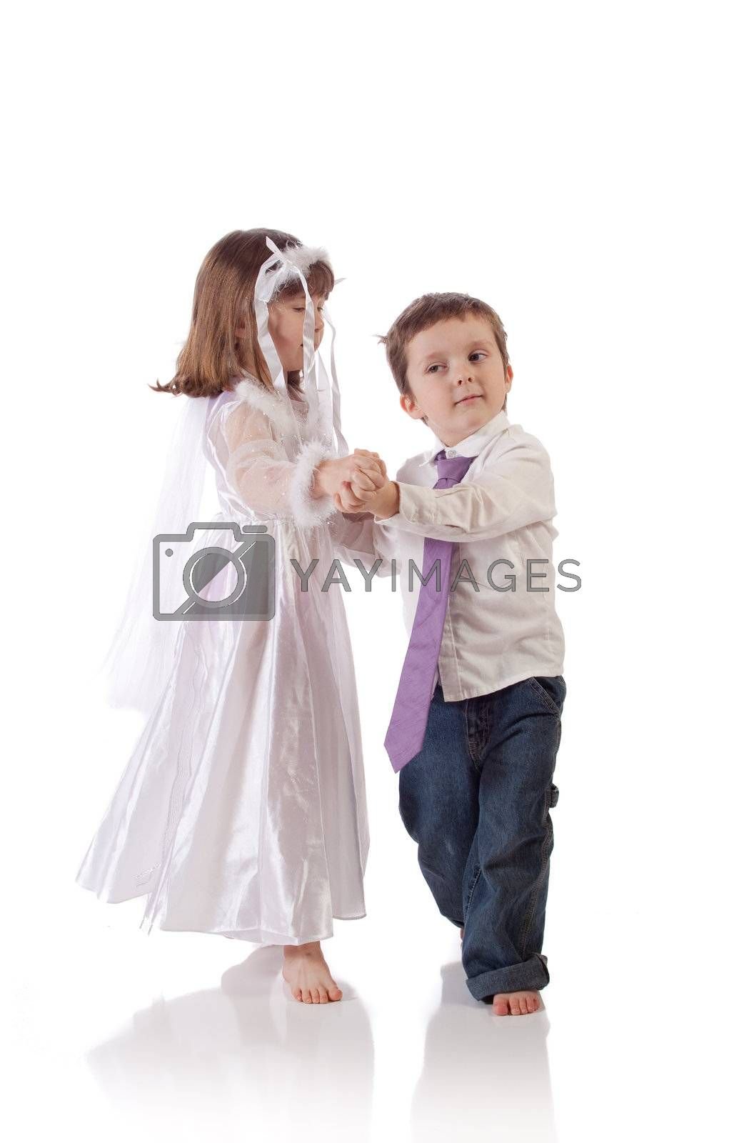 Cute little boy and girl dancing together