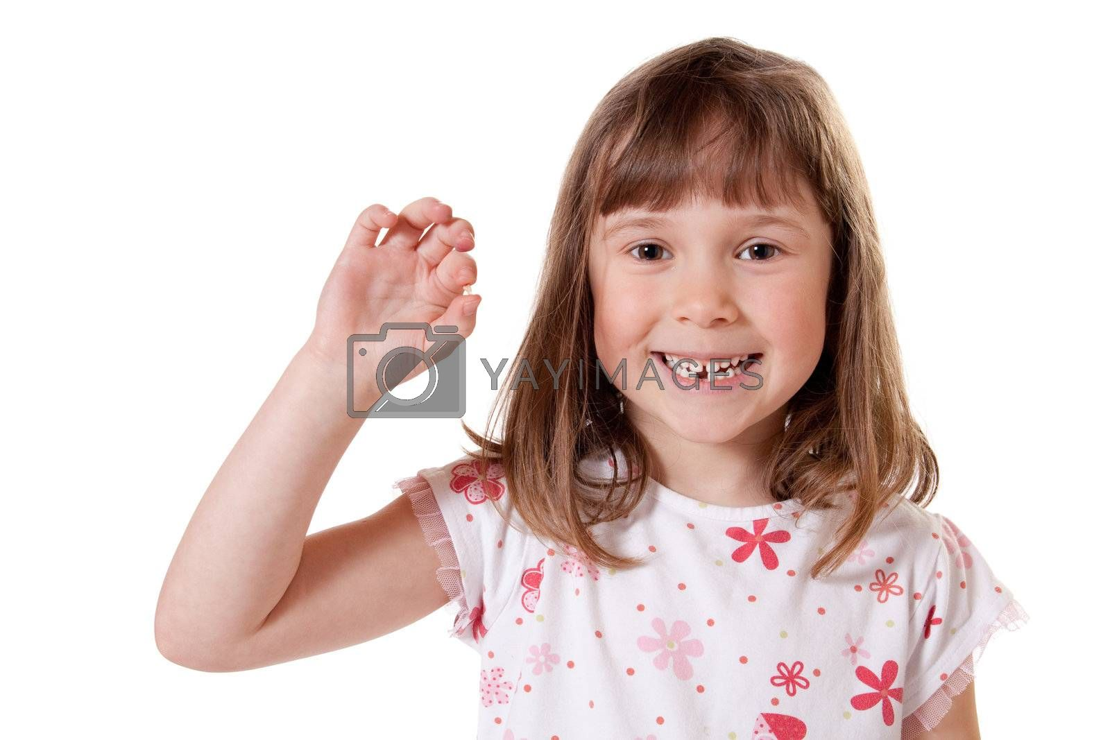 Cute little girl showing the first tooth she lost