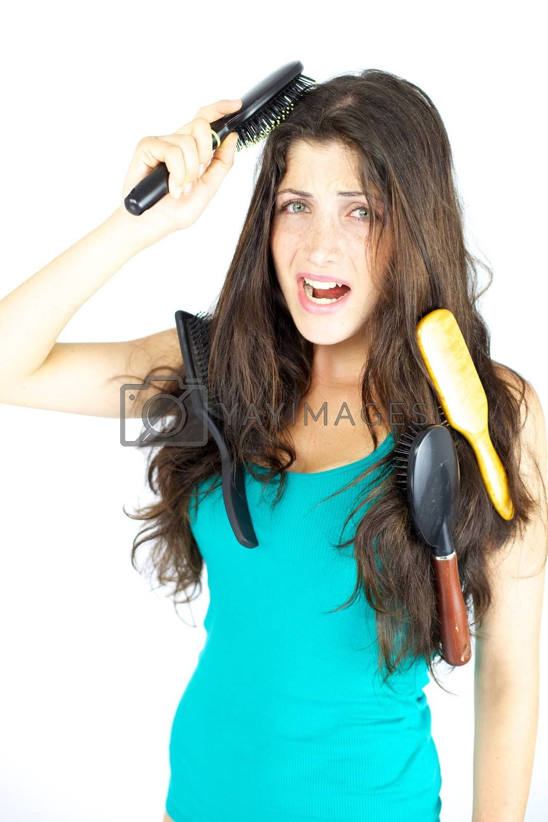 Woman stuck with brushes in her hair screaming loud, tangled hair