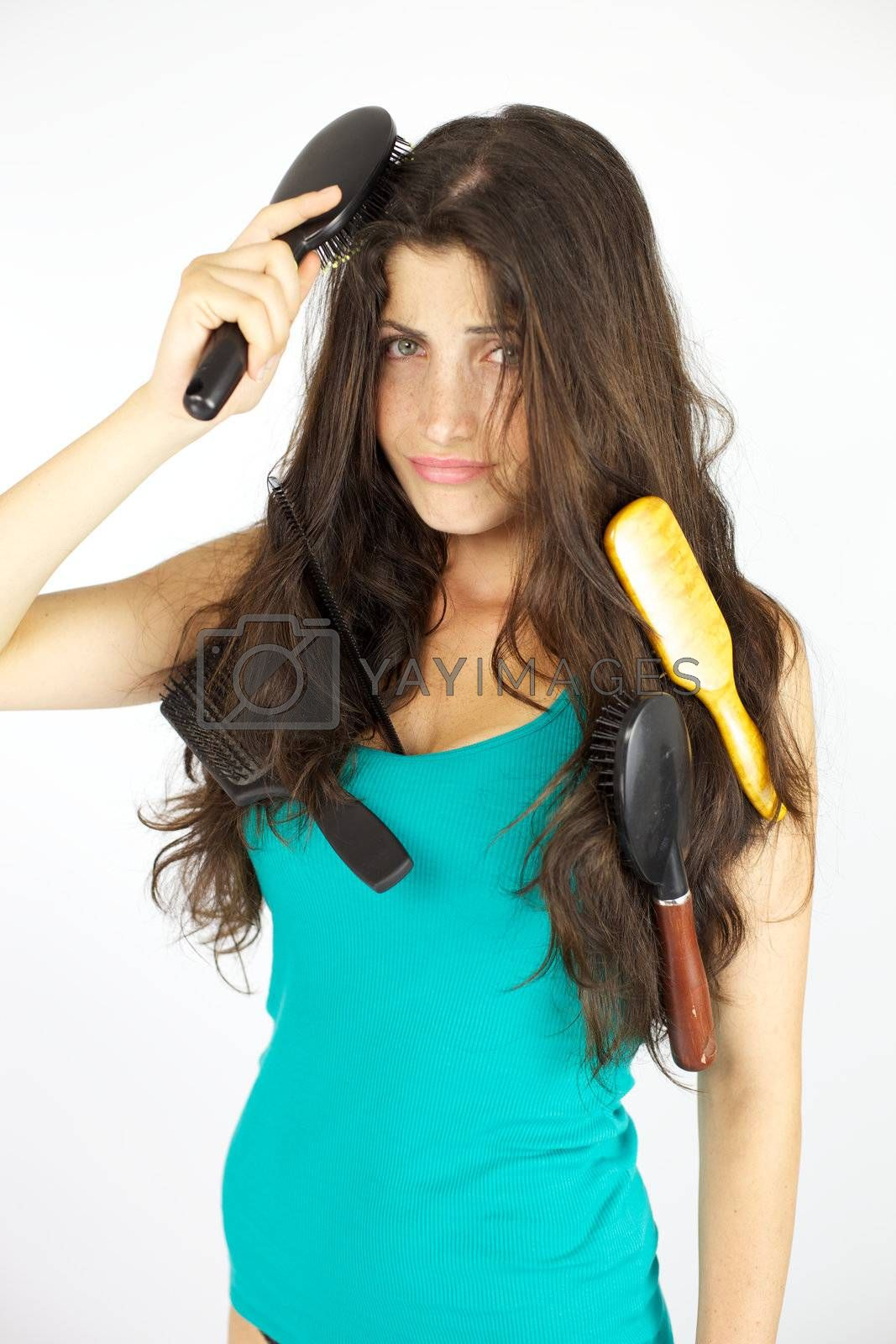 Woman with wavy long hair not able to brush them in the morning