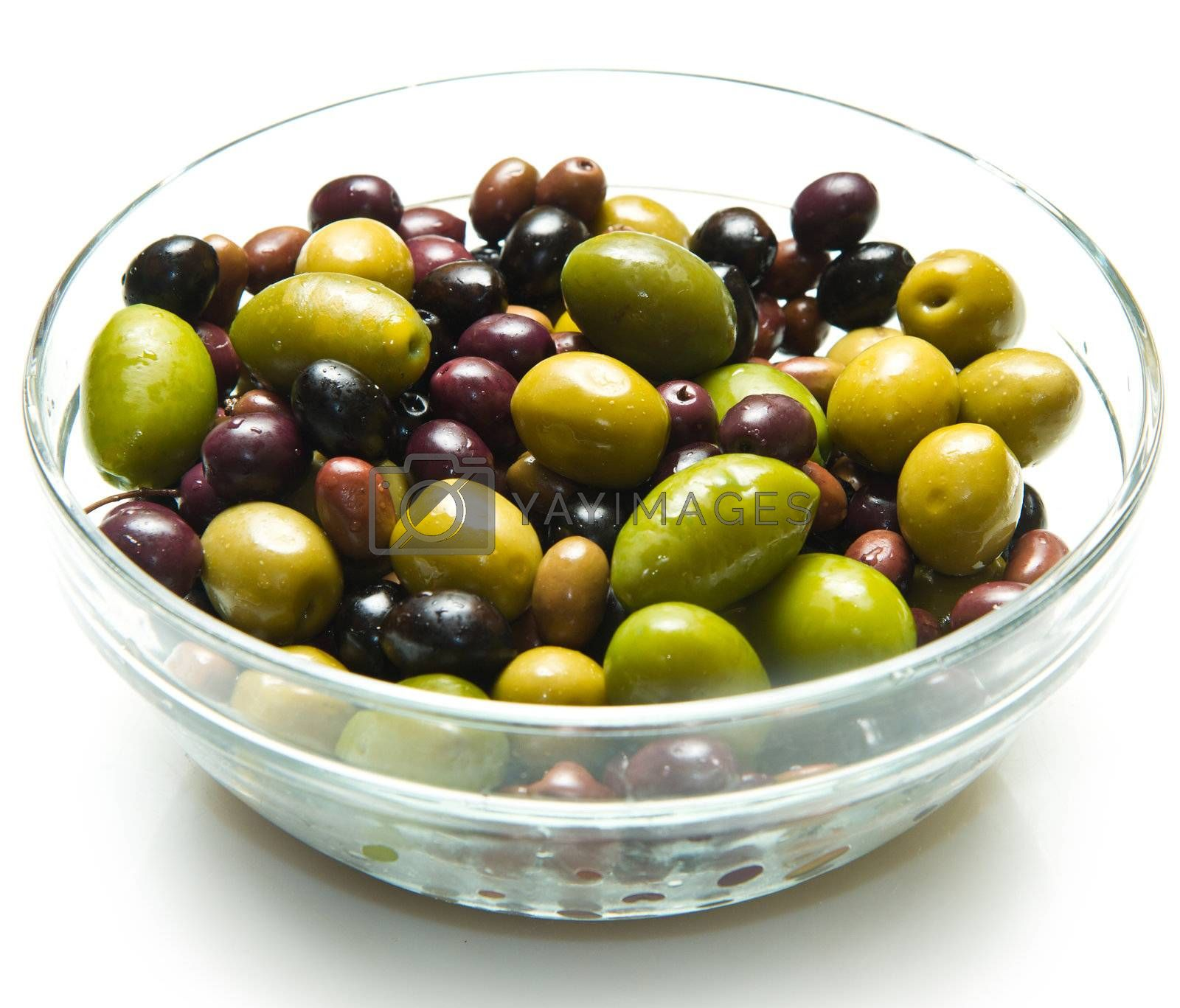 different kind of green and black olives on white background