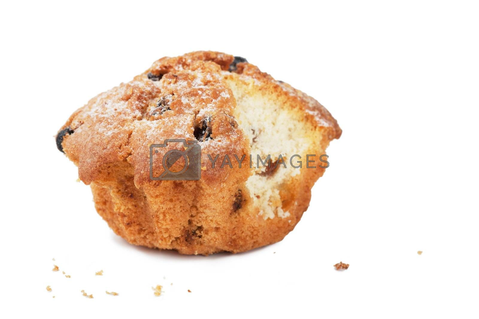 Closeup view of single cake with raisins over white background
