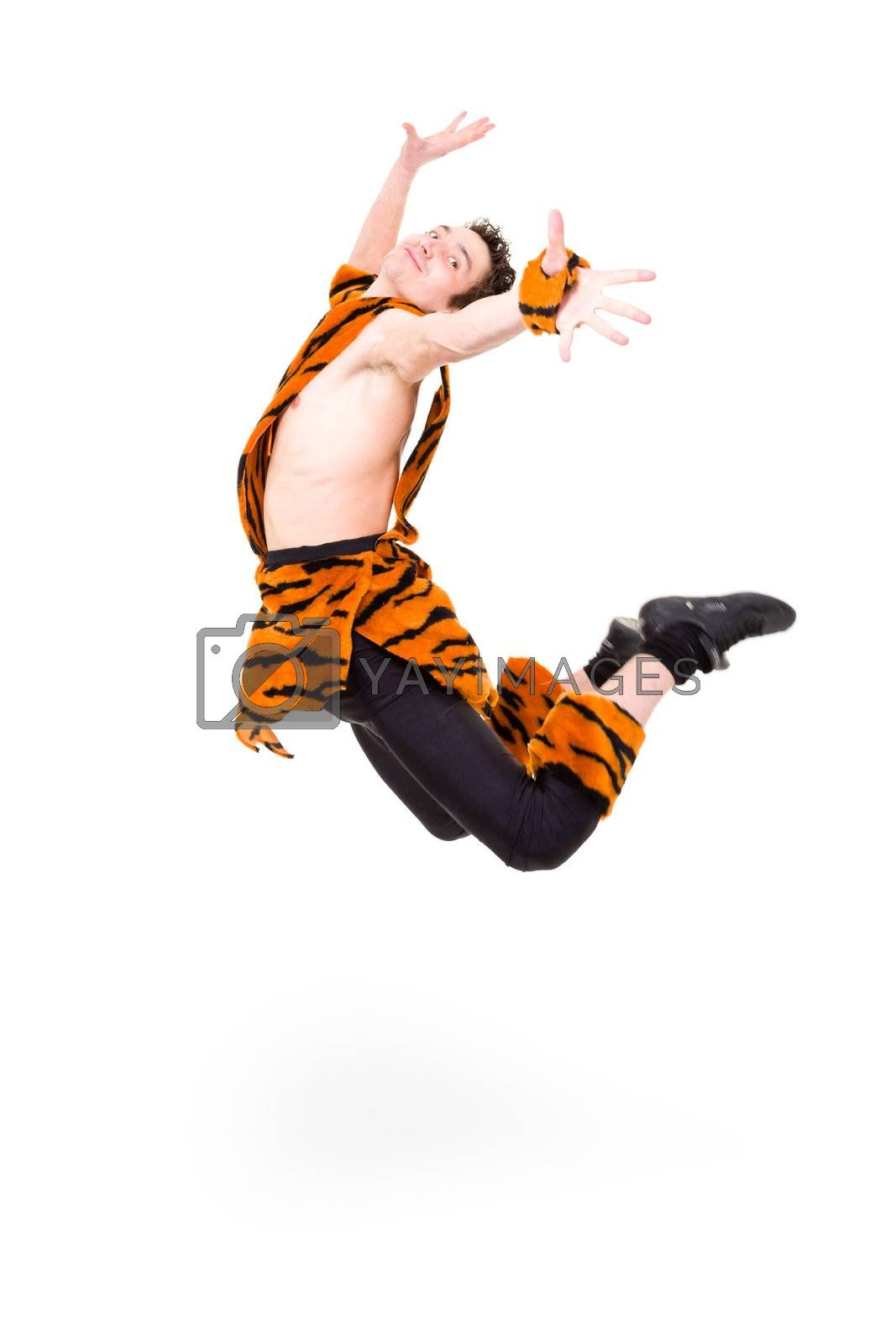 Wild man wearing a tiger fur jumping against isolated white background