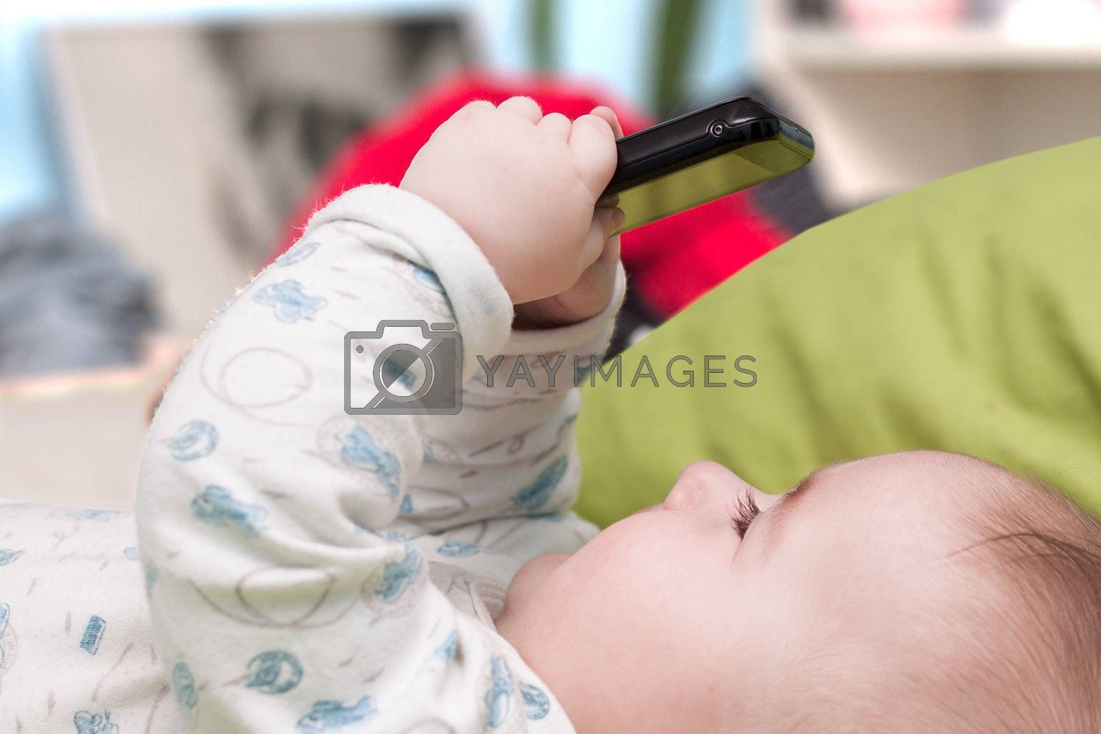 Baby with a mobile phone in his hands