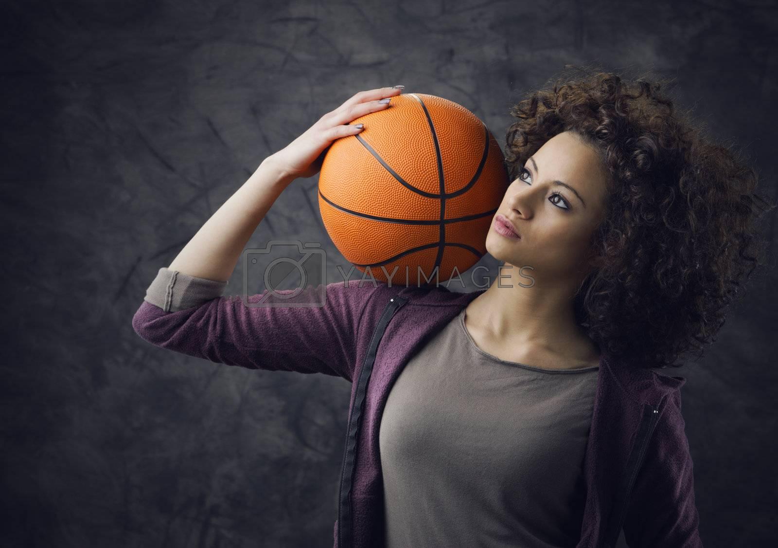 Fashion model  holding a basketball