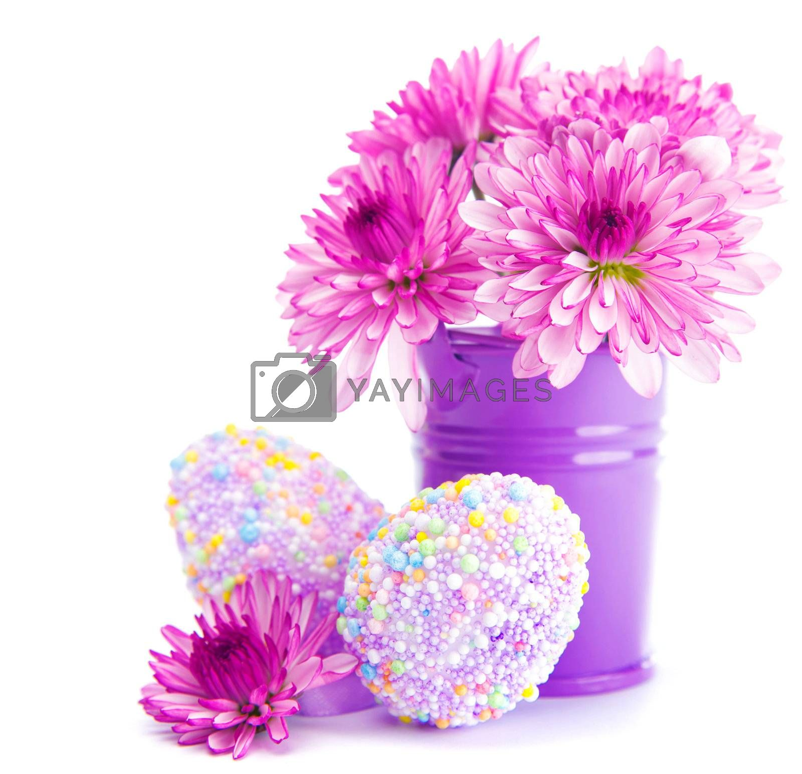 Beautiful festive Easter still life isolated on white background, spring time holiday, colorful eggs with fresh pink flowers bouquet