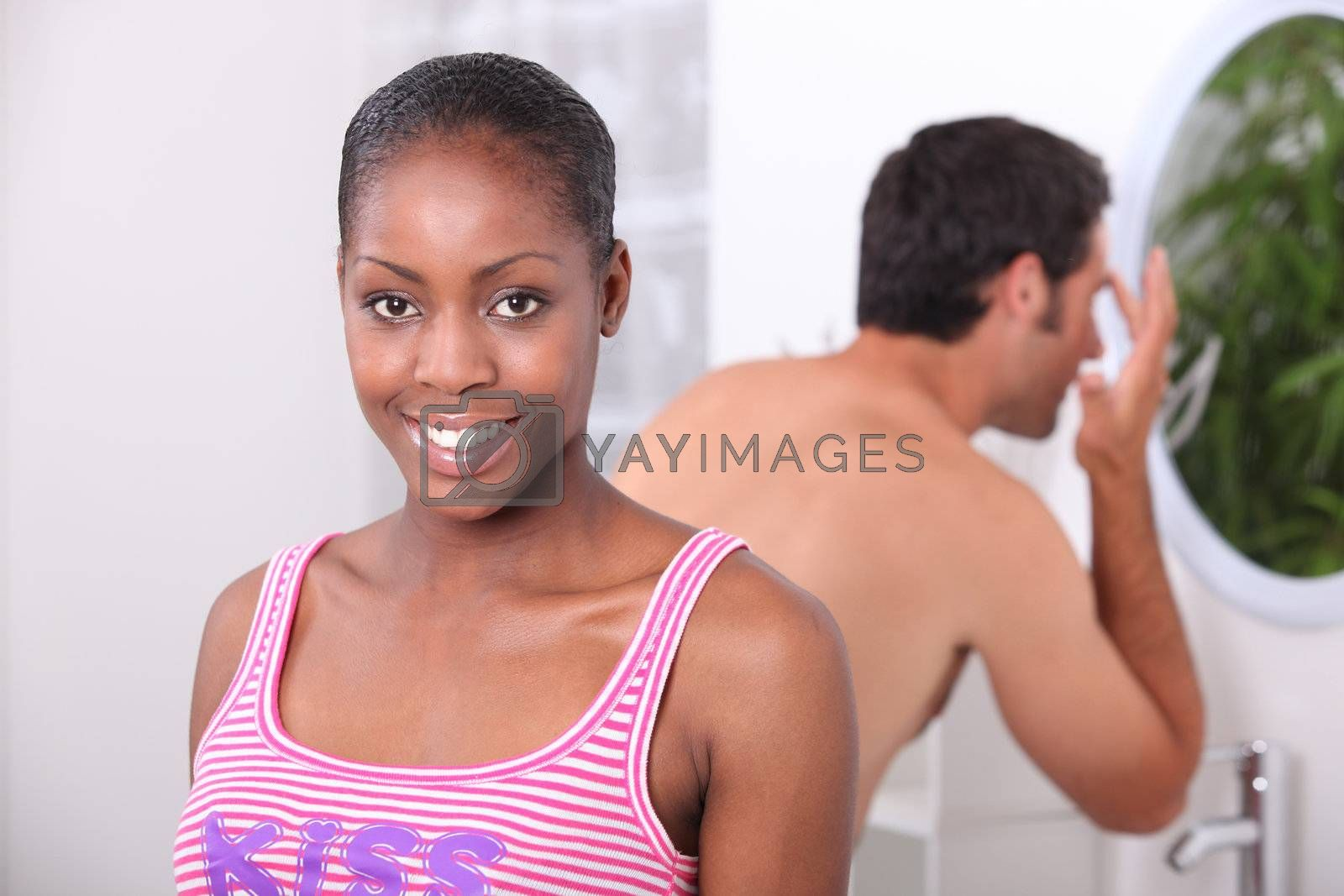 black woman and his boyfriend in the bathroom, the man has a wash