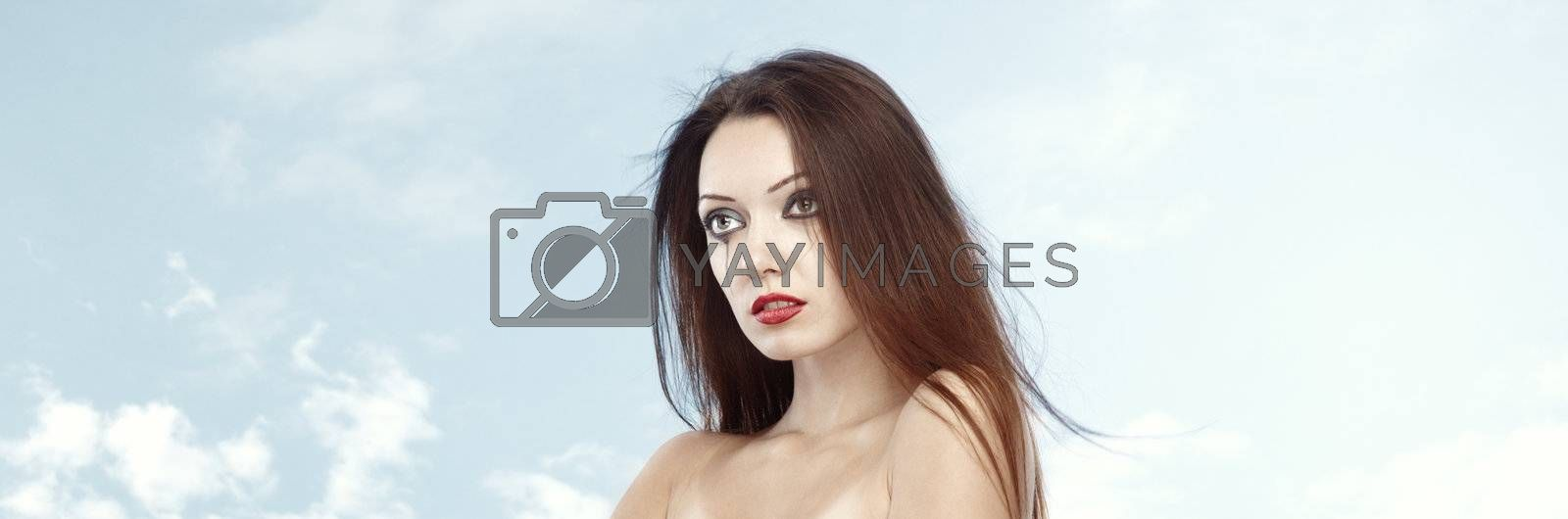 Gothic lady outdoors on a sky background