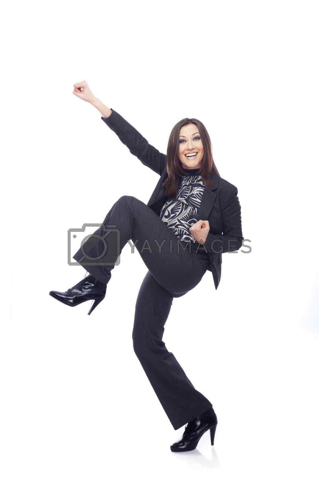 Successful businesswoman in trouser suit on a white background