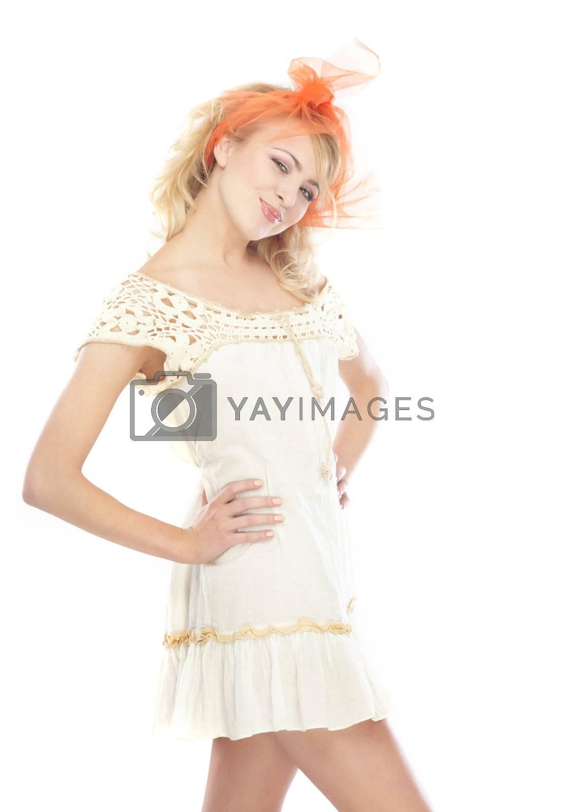 Stylish woman akimbo posing on a white background