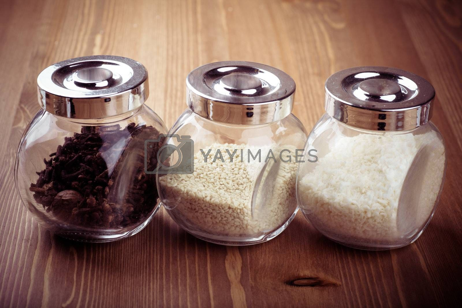 Closeup view of small glass jars with spices