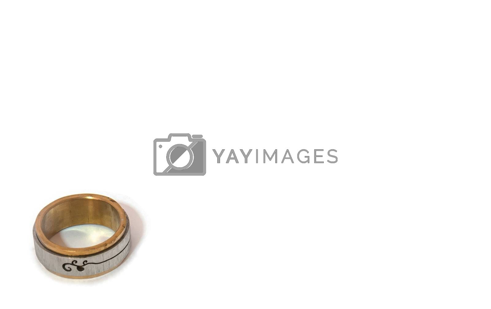 The isolated picture of one silver and golden ring
