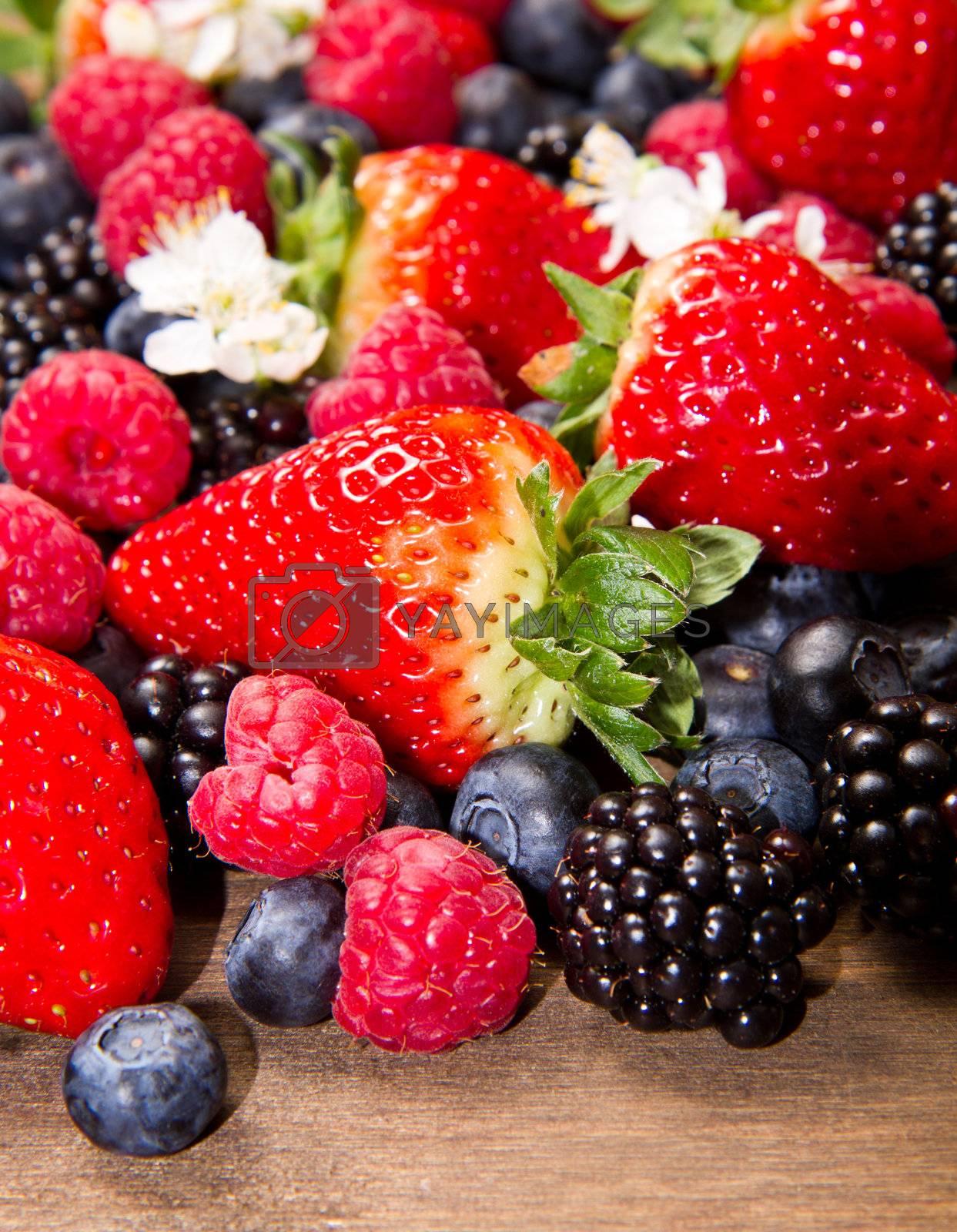 Berry over Wood. Strawberries, Raspberries, Blueberry