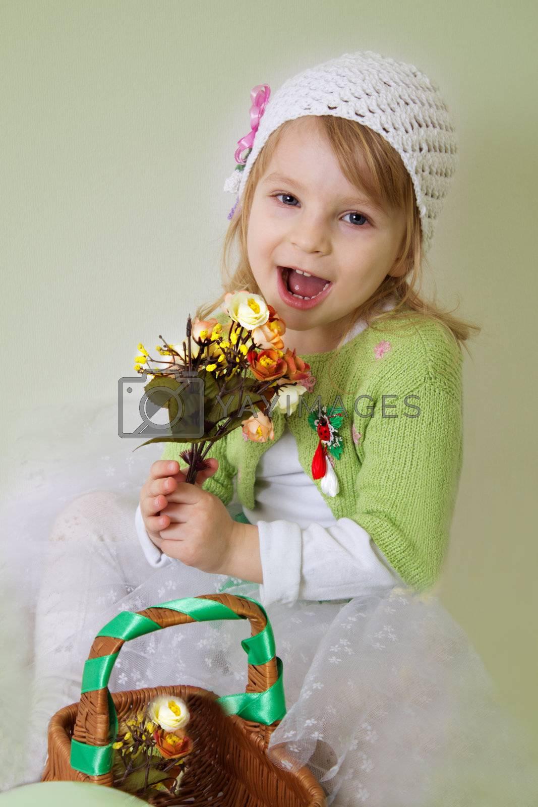 Cute girl enjoying spring flower blossom with basket