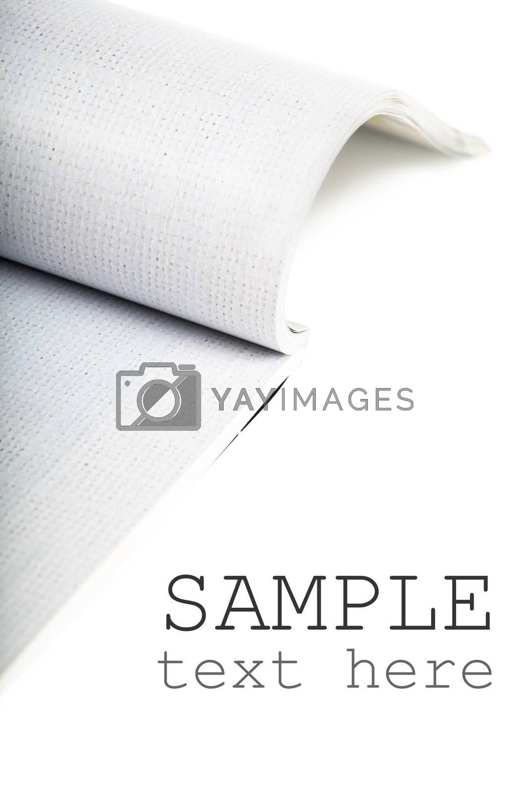 Selective focus image of magazine over white background