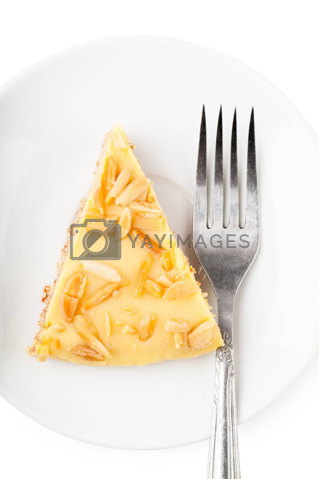 Closeup view of piece of sweet pie and fork on a white plate