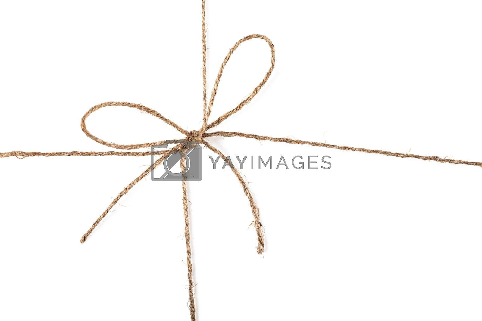 Closeup view of string knot over white background