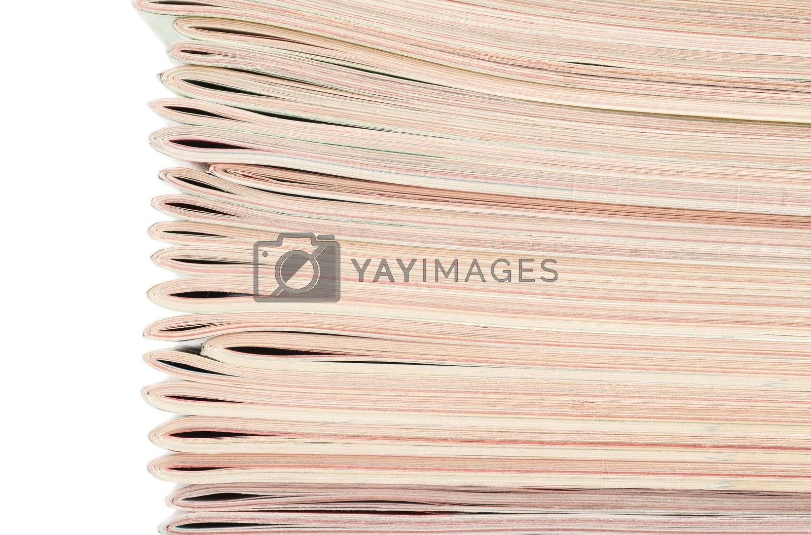 Closeup view of stack of magazines isolated over white background
