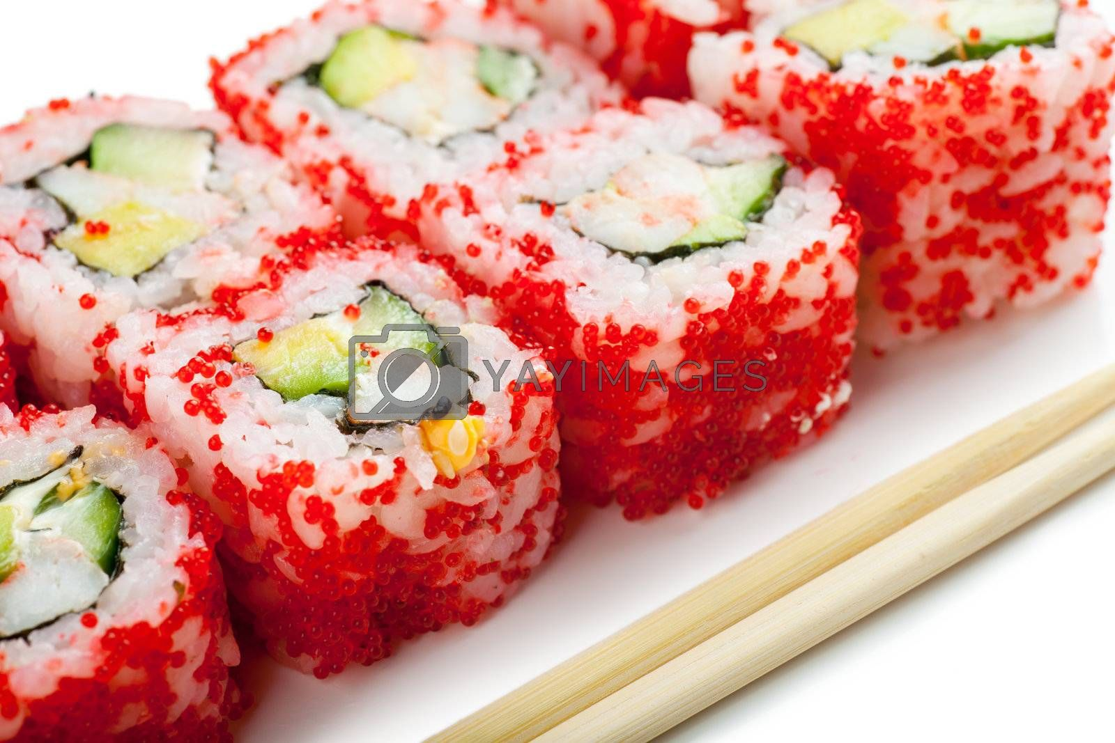 Close up top view of sushi and chopsticks over white background