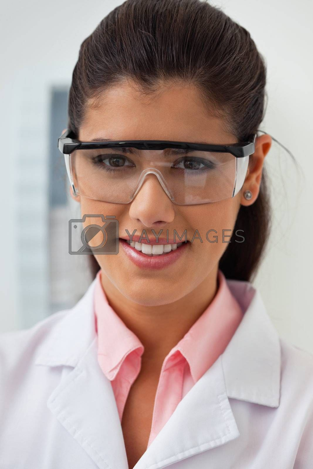 Portrait of smiling female dentist at her clinic