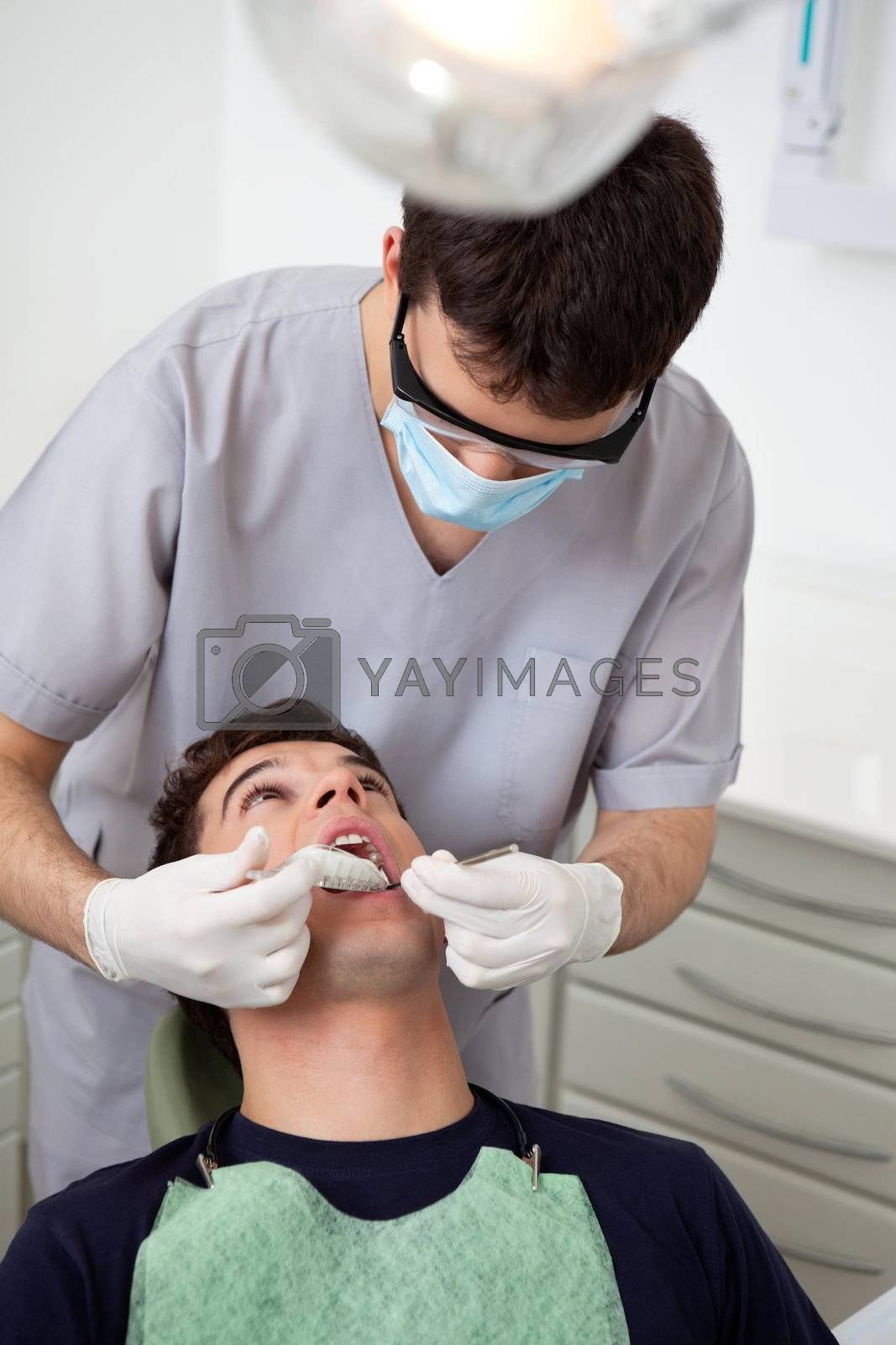 Dentist making a cast of patients teeth