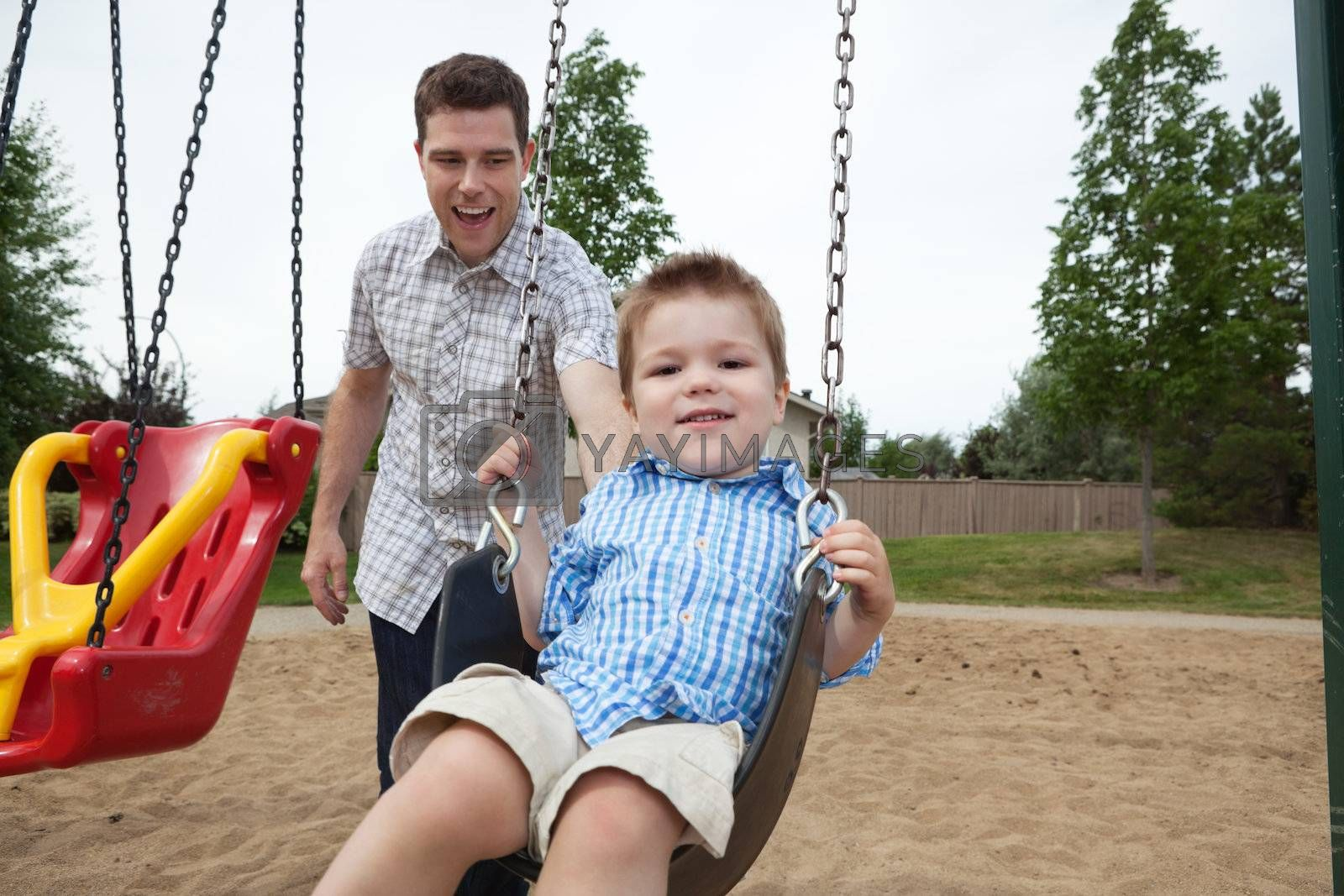 Father and Son in Playground by leaf