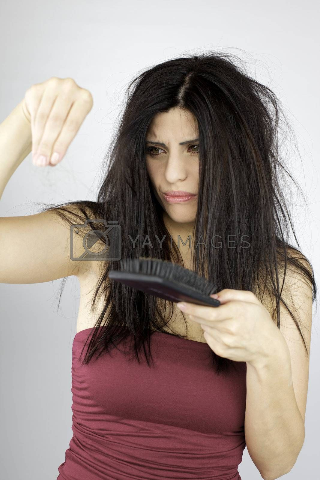 Angry beautiful woman loosing hair