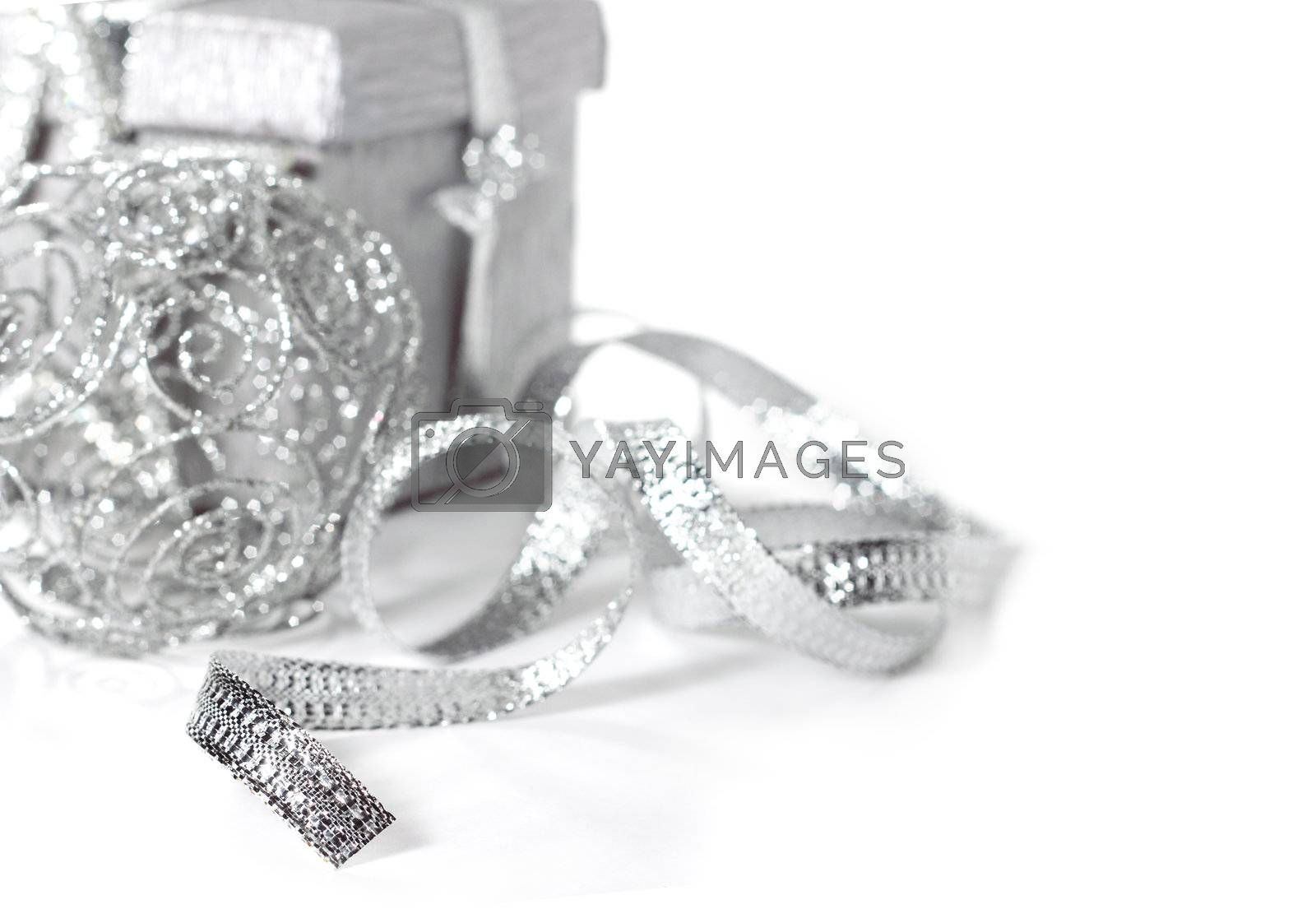 Silver christmas gift with decoration isolated on white background