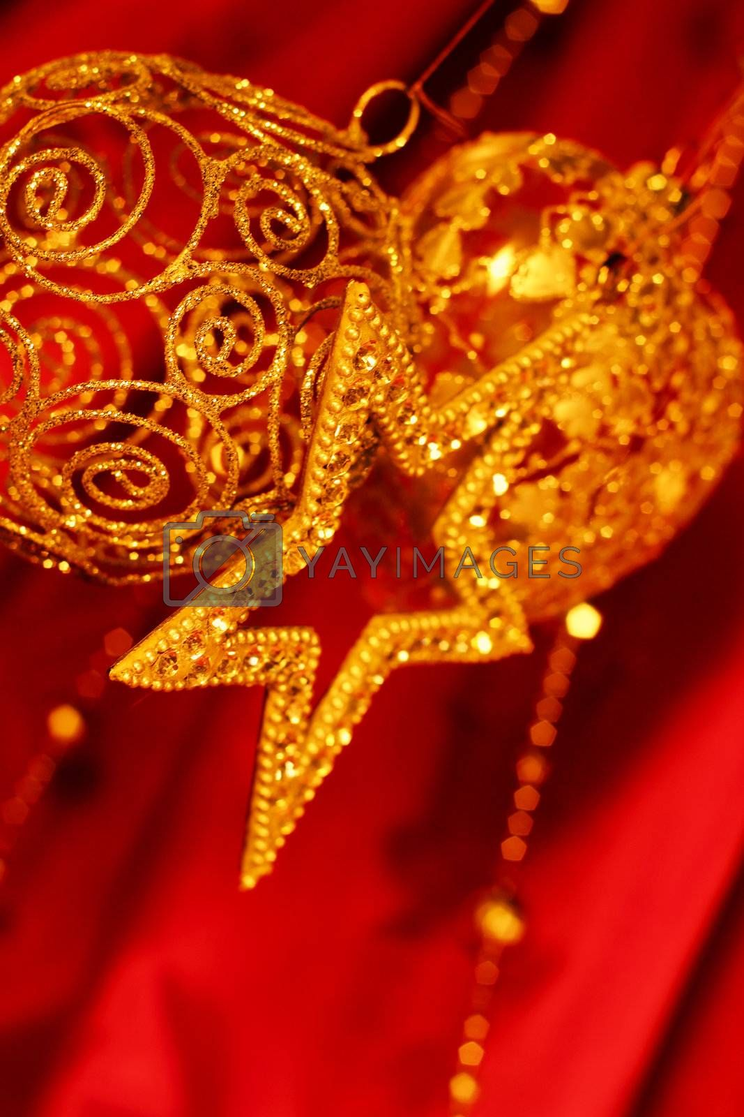 Golden christmas decoration on red fabric background