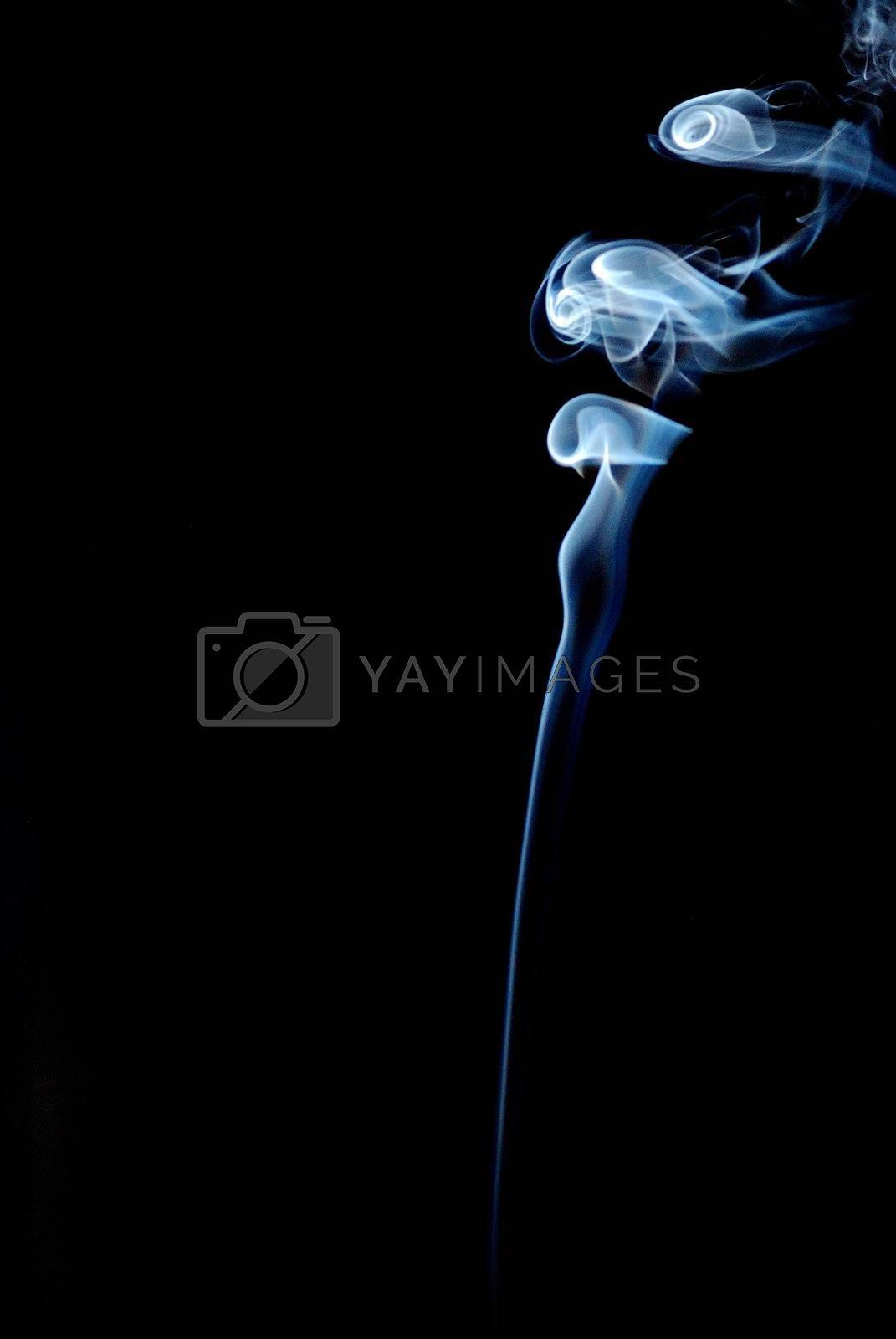 smoke heavily swirled right with black background