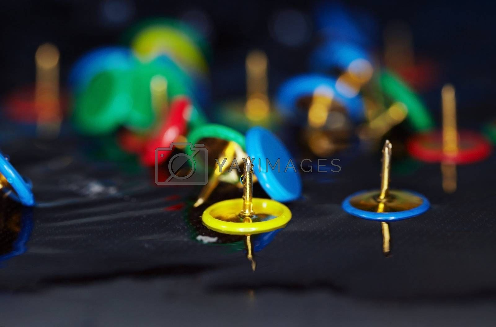 Extremely close-up macro photo of the pushpins in the water. Shallow depth of field and vibrant color for natural view