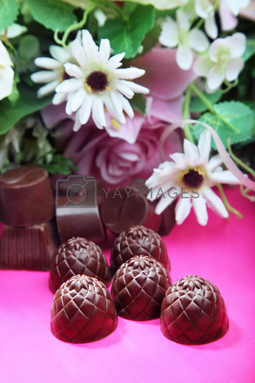 Chocolate sweets and flowers by Novic