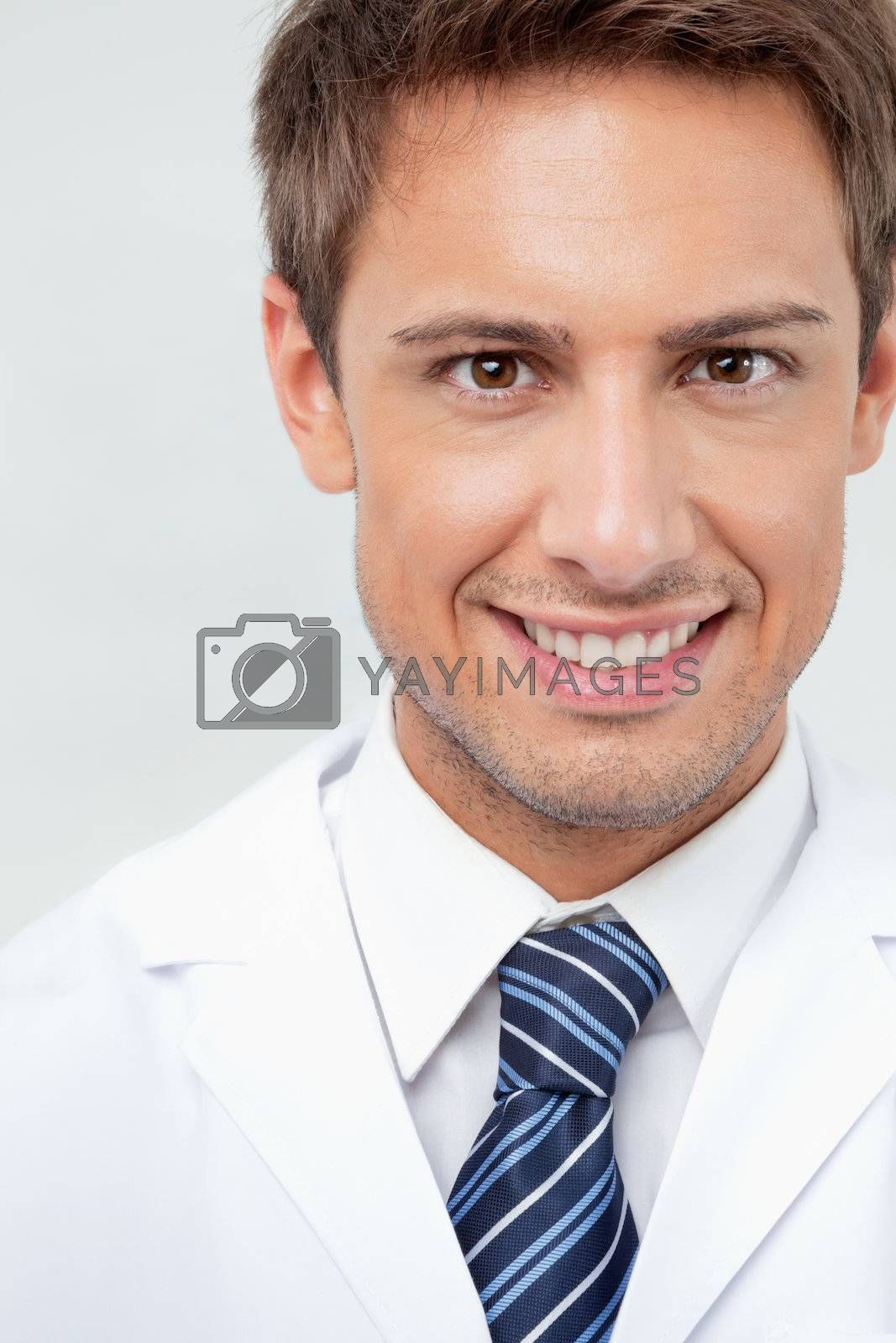 Closeup portrait of male dentist smiling