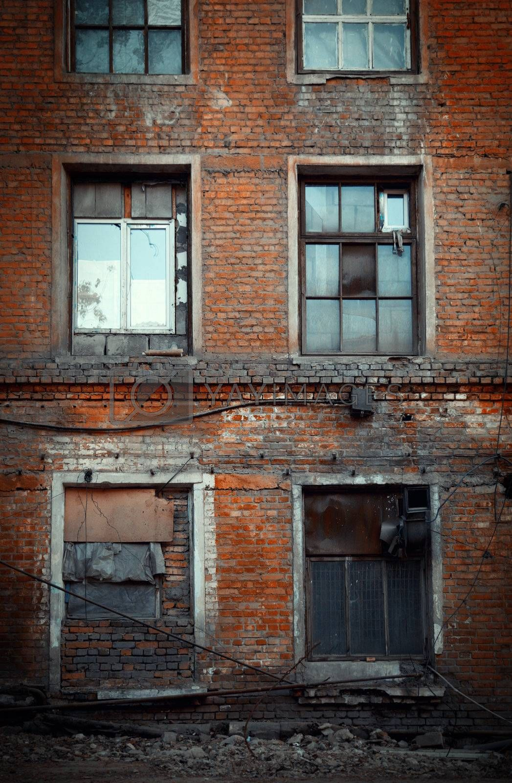Old building of the red bricks. Vertical photo