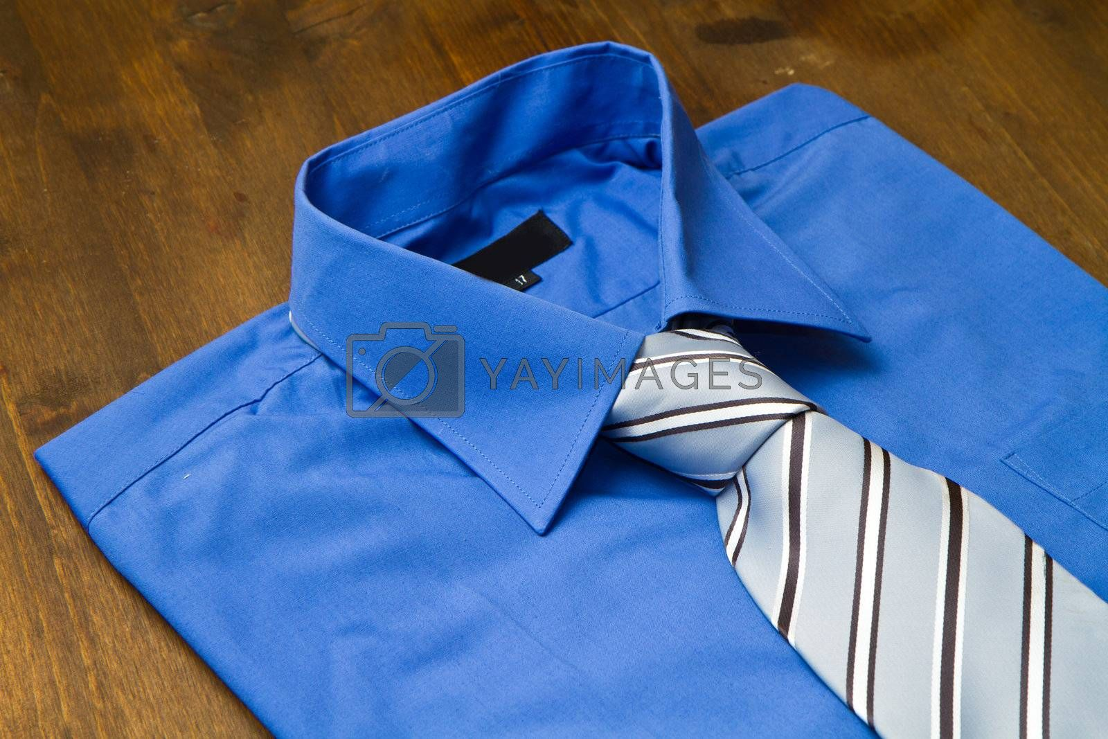 New blue man's shirt and tie isolated on wood