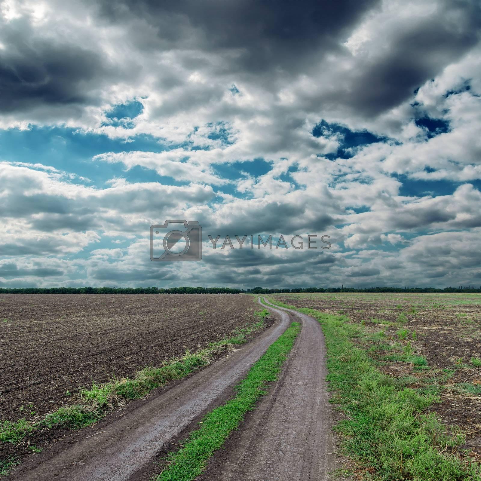 dirty road to cloudy horizon