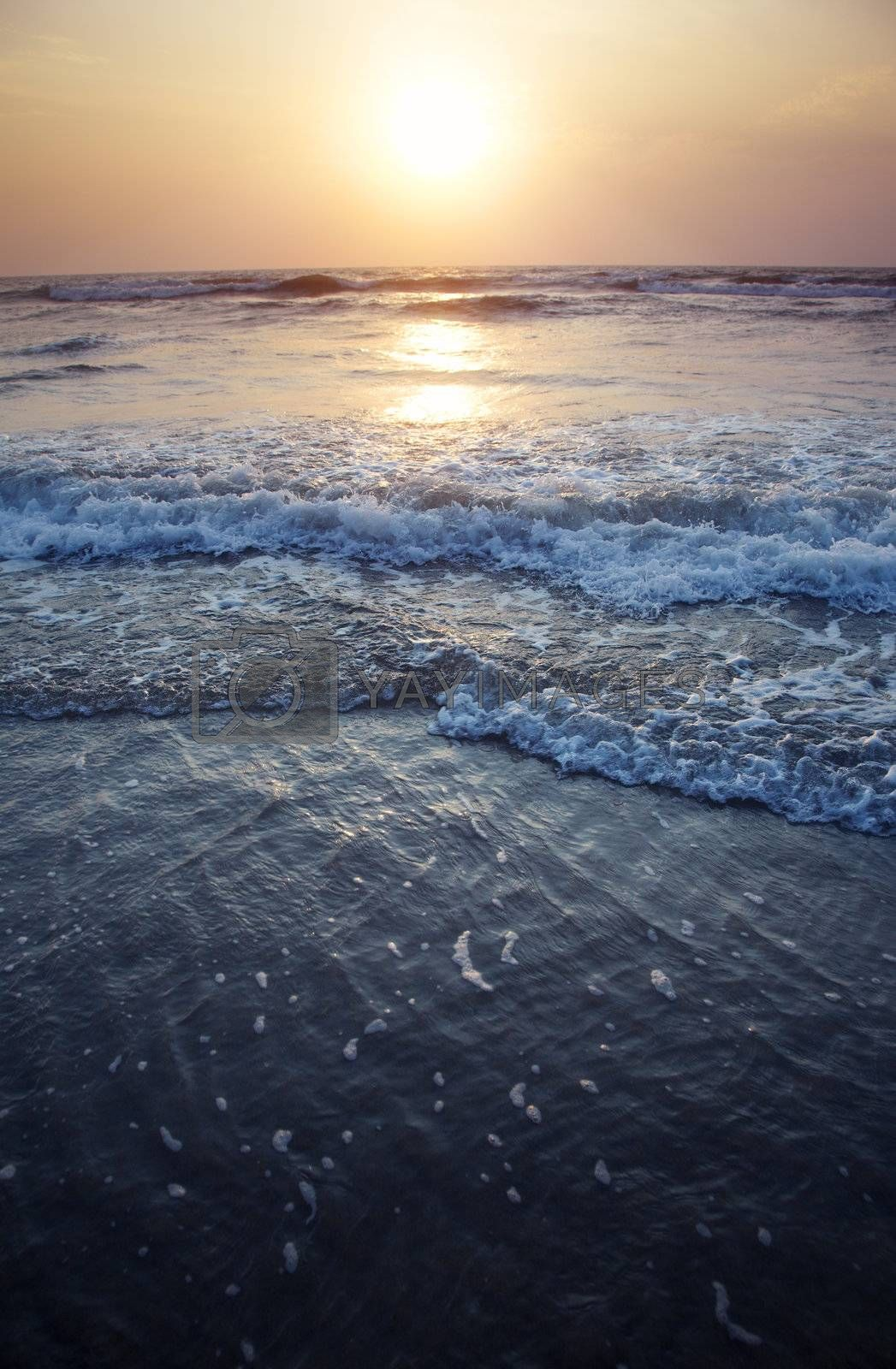 Twilight sea during sunset. Vertical photo with dark and dramatic  colors