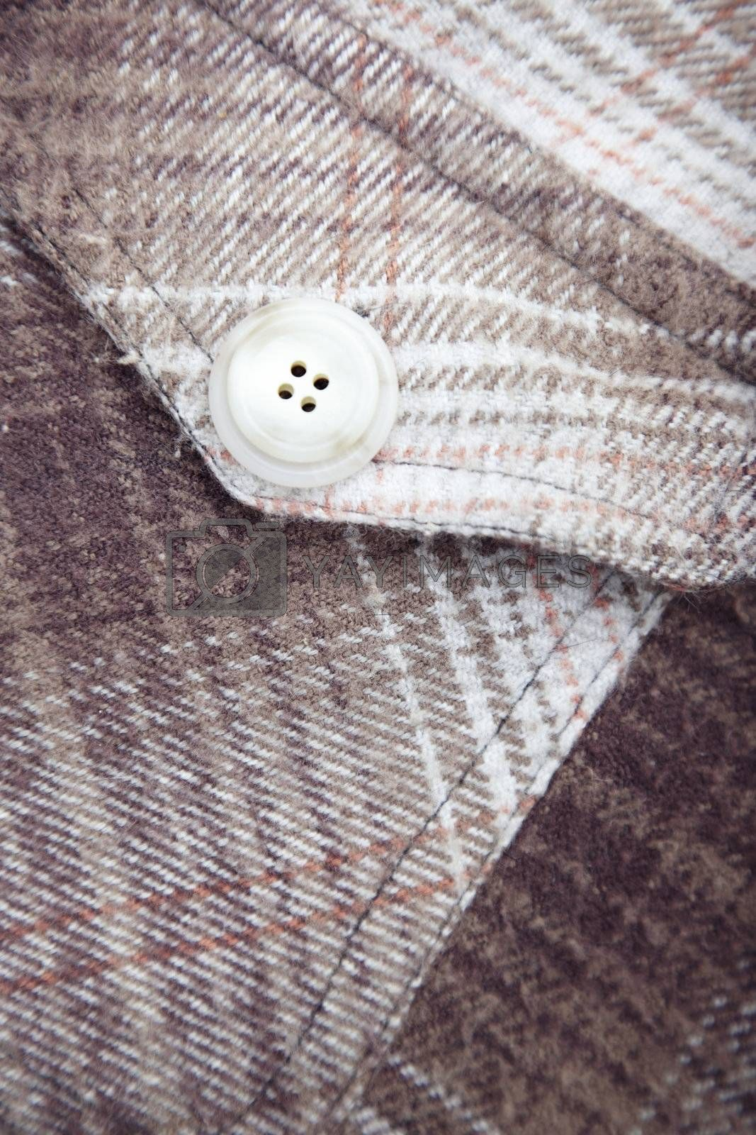 Pocket with button of the frieze shirt. Close-up photo