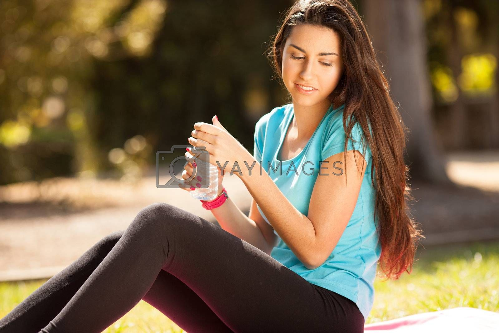 young beautiful woman about to drink water after sport