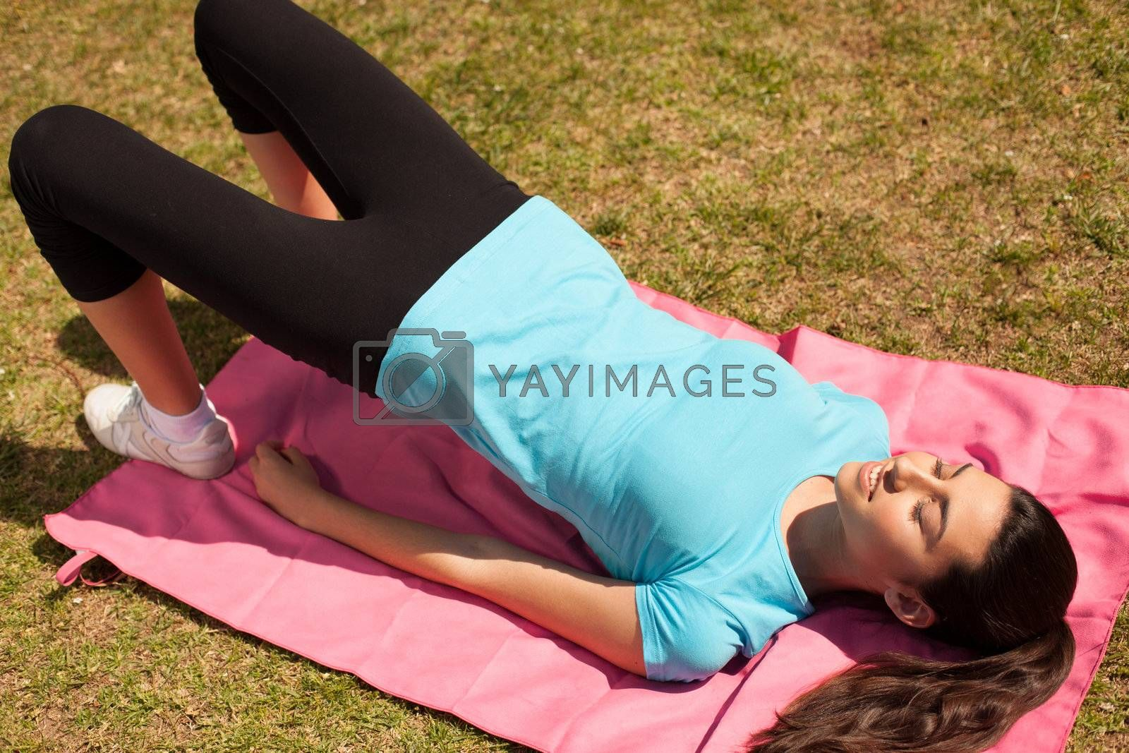 young beautiful sport woman working on outdoors