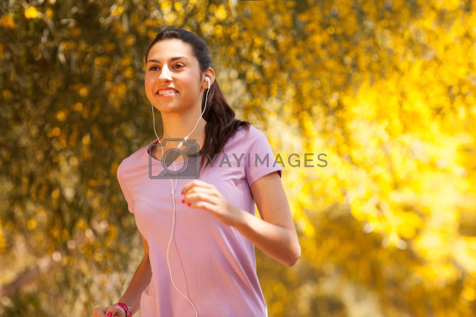 young beautiful woman jogging outdoors