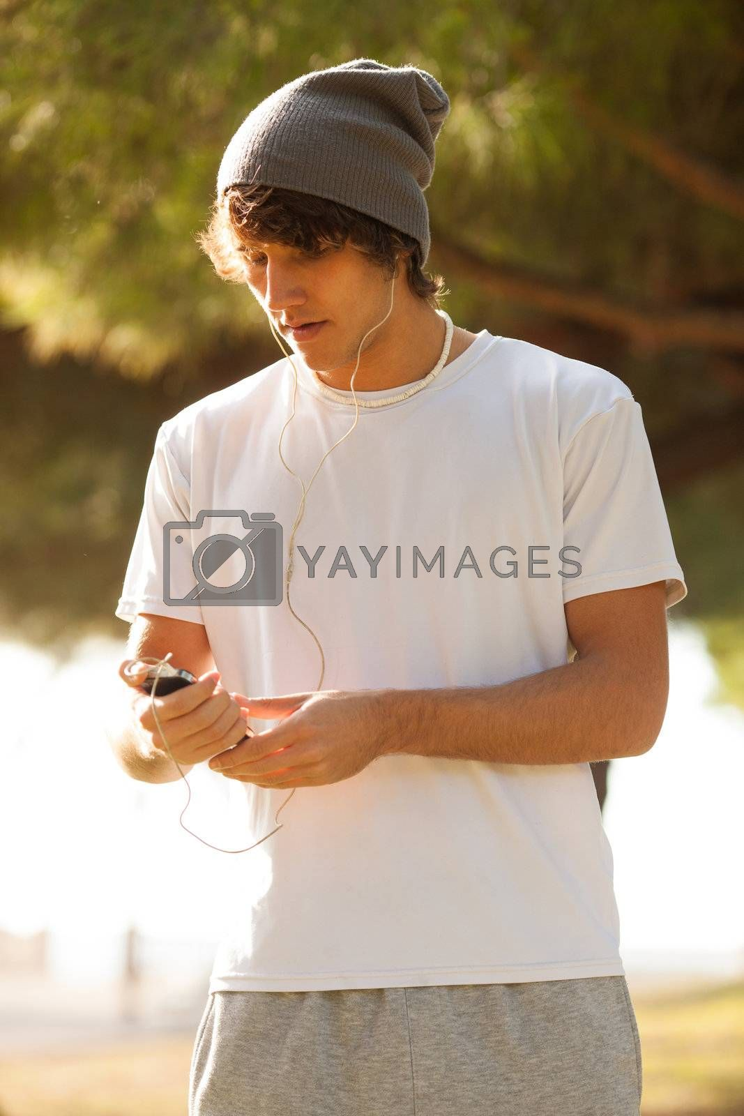 young handsome man consulting phone outdoors