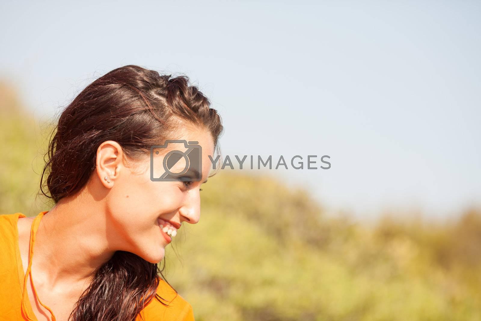 Portrait of young beautiful woman laughing wearing orange shirt